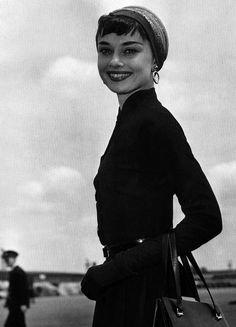 Audrey Hepburn arriving at Heathrow Airport in London, 1953.