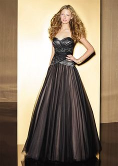 This elegant soft tulle ball gown from Love 16 features a sweetheart neckline, an asymmetrical ruched bodice with a beaded band on empire waist, inverted pleaded tulle skirt and a corset back. Bridesmaid Dresses, Prom Dresses, Formal Dresses, Wedding Dresses, Bridesmaids, Tulle Ball Gown, Ball Gowns, Bridal Boutique, Dress Collection