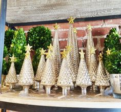 Love these glass trees for the mantel! COCOCOZY: DECEMBER DO - TIME TO DECORATE