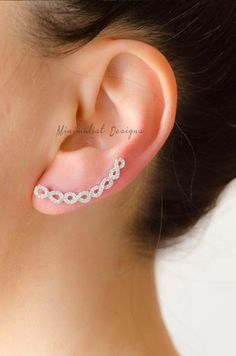 Sterling silver two ear cuffs(one pair) with infinity shaped cubic zirconias. This listing is for two ear cuffs (one pair) . Available in