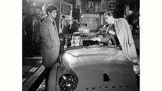 Sâmí Frey (at left), Brígítte Bardot (at centre, in a Triumph TR3) take direction from director Hénrí-Géorges Cloûzót whilst filming a scene for 'Lâ Véríté' at Lés Studíos dé Joínvílle, in May 1960
