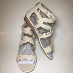 BRAND NEW CREAM SANDALS Brand-new never worn Aldo sandals. Cream colored gold zipper up the back. Size 39. ALDO Shoes Sandals