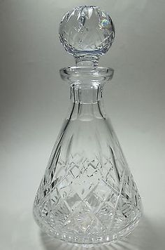 "Up for auction is this cut glass signed Waterford Hand Cut Irish Crystal Lismore decanter It is cut in the old tradition by stone wheel. 10.5"" Tall with stopper 5"" in diameter and weighs 3.5 lbs. In v"