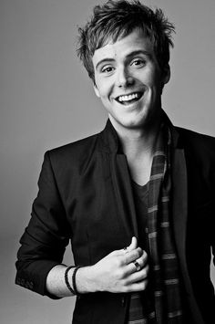 Caleb Grimm, he has the most amazing voice EVER!! <3 Ughh... why is he 25?!?