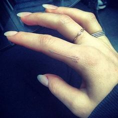 White Ink Finger Arrow Tattoo.