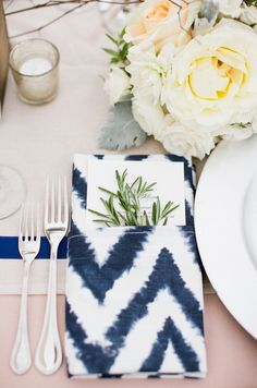 Ikat navy and white table accents are nautical with a modern twist: http://www.stylemepretty.com/vault/gallery/38292 | Photography: Meredith Perdue - http://www.meredithperdue.com/weddings/