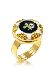 Fleur De Lis Ring     By Hila David     Want to get noticed? This is the ring for you! Interesting ring conveys great presence and character.  Featuring innate nobility icon next to stones with black and cream enamel.     Item details:  enamel  Brass  24k gold plated  Nickel free  Adjustable upon request – no additional charge!