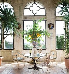 Adjacent to the grand salon is a sunroom with quatrefoil windows and whimsical furniture designed by owner Joy de Rohan-Chabot.  I <3 the butterfly table!!