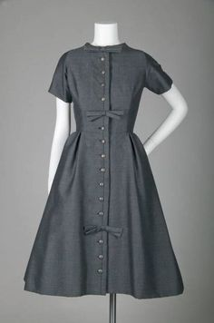 """Afternoon Dress, Yves Saint Laurent for Christian Dior, France: 1958, wool tweed, under-skirt of tulle. """"This dress is from Yves Saint Laurent's historic first collection for the House of Christian Dior in 1958. The Trapèze was introduced with this collection, though the entire collection did not adhere to the new A-line silhouette. It is interesting to note that this dress still clings to the New Look silhouette of 1947."""""""