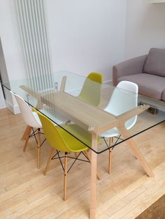 Glass table, Eames Eiffel chairs This is just about exactly what I want