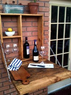 no-cost pallet outdoor wall hanging and folding down bar #outdoordiybar