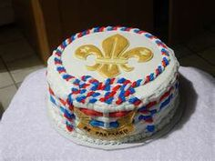 This cake made for an Eagle Scout awards ceremony, has the fleur de lis made of color flow and dusted with edible gold dust. The rest of the decoration is buttercream.