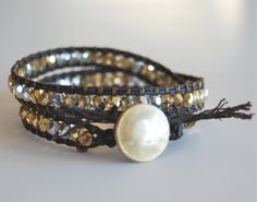 DIY bracelet: http://makebraceletsblog.com/2011/01/12/beaded-wrap-bracelet-video-tutorial/
