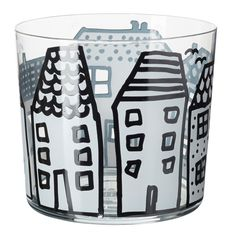 Glass tumbler with big and small houses decorated around. Donna Wilson's signature naive illustrations are references of her home in Scotland where she grew up.