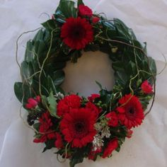 Remembrance wreath with foliage base and freash floral sprays. Please request colours required in order note