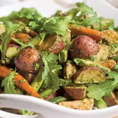 Roasted Spring Vegetables with Arugula Pesto  These roasted vegetables tossed with arugula pesto are an easy side for a dinner party.  @eatingwell #asparagus