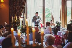 Wedding speeches, grooms speech with candles.  Wedding photography at Matfen Hall by 2tone Photography.