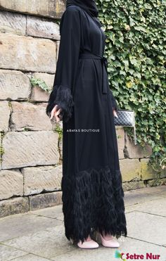 There's no denying the playful aesthetic of this feminine fringed kimono style abaya. The slender silhouette is deeply flattering, featuring luxuriant fringed cuffs and hem. Complete the look by pulling focus to the coordinating fringe hijab and belt. Abaya Fashion, Muslim Fashion, Kimono Fashion, Fashion Outfits, Hijab Style Dress, Kimono Style, Hijab Evening Dress, Bohemian Summer Dresses, Modele Hijab