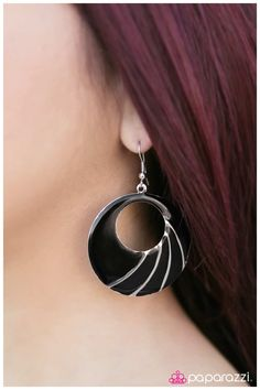The Visionary  A thin silver circle cut into an alluring crescent shape falls from the ear in a glamorous fashion. Glazed in a shiny black finish, decorative silver lines swoop towards the bottom of the frame for shimmery texture. Earring attaches to a standard fishhook fitting.  Sold as one pair of earrings.