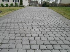 Stamped Concrete Driveway - stamped with a deep cut cobblestone pattern. Concrete Patios, Stamped Concrete Driveway, Concrete Backyard, Stamped Concrete Designs, Concrete Patio Designs, Cobblestone Driveway, Asphalt Driveway, Driveway Installation, Driveway Landscaping