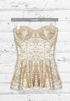Gold sequined peplum stapless top.