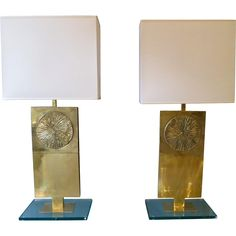 A pair of handmade  Italian brass table lamps with thick glass bases sunburst decoration and white rectangular shades. Max height 86cm h x 40cm w x