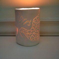 Simple ceramic tea light holder. Just poke a few cocktail sticks through and voila!