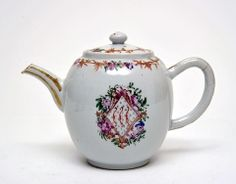 Teapot, c.1765-75  Porcelain, coloured enamls and gilt  Chinese Export Ware  Unmarked  Decorated with the Arms of Mary Eleanor Bowes, Countess of Strathmore (1749-1800)