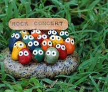 funny painted rocks concert sign. ~~ I love this, and I'm so making one- I love going to concerts& this Would look cute even sitting in a large house plant pot. Love this!