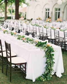 A Fashionable Country-Club Wedding in St. Louis   Martha Stewart Weddings - Inspired by vintage photographs of Jackie Onassis and John F. Kennedy's wedding, the couple selected similar long tables with greenery down the center for the outdoor party, which was held just steps from where the ceremony had taken place.