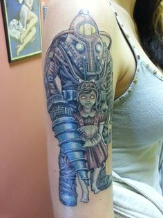 done by pup at all american tattoos.its subject delta and elanore from bioshock 2 Bioshock 2, Bioshock Tattoo, Pretty Tattoos, Cool Tattoos, Awesome Tattoos, Video Game Tattoos, Gamer Tattoos, Gaming Tattoo, Dream Tattoos