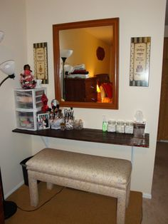 I couldn't afford to buy the IKEA makeup table I really wanted, so hubby made one for me using a 5 foot piece of stained wood and some braces. The best part is the bench I discovered at the Goodwill store and had recovered! This vanity serves its purpose and was extremely inexpensive to create.