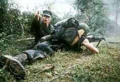 A Marine M60 team lies low, but clearly the assistant gunner has seen something. The assistant gunner wears an eight-point utility cap, while the M60 gunner wears an ARVN rucksack, apparently with foam padding for added comfort. He also uses the lacing method commonly found in Vietnam on his jungle boots.