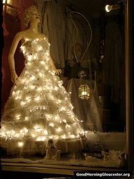 String some lights on a mannequin to bring holiday cheer to your window