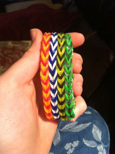 Harry Potter house colour ( in order of - Gryffindor,Rabenclaw,Hufflepuff and Slytherin) rainbow loom quad fishtail (my variation of the triple fishtail)