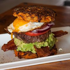 """5280 Meat® on Instagram: """"Monday night burger!  I made sweet potato """"buns"""" by grating a medium sweet potato and adding in an egg to hold the pieces of grated potato together. I then formed patties and fried in a skillet in @omgheebutter. Next I added guac, two slices of our 5280 Pork® Smoked Bacon, our 5280 Beef® Hamburger seasoned with @flavorgod Garlic Lovers & Everything seasonings, onion, tomato and our farm fresh egg fried in OMGhee."""