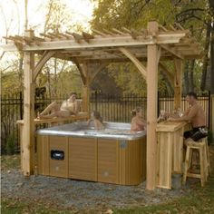 A Pergola Makes for a Great Hot Tub Cover! Didn't think about including a bar before...