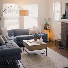 overarching lamp, storage coffee table, vines rug | West Elm