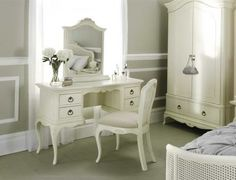 The stunning Ivory French Dressing Table with chair and armoire. A stunning collection that looks fantastic.