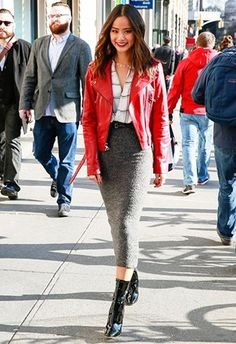 Jamie Chung in a red leather jacket, checked shirt and grey midi skirt