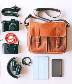 The leather Prince Street messenger in antique cognac paired with a Leica camera kit.