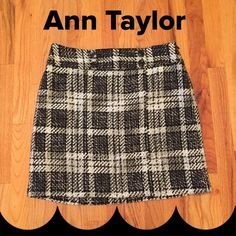 """EUC!!!  Ann Taylor Plaid Skirt Great anytime wear from casual to office, boots or tights and flats. Excellent condition. Fully lined. Black, Gray and White. Cute accent double button belt. Measures 18.5 from waist to hem, 16"""" across waist. Price firm, bundle and save $$$. Ann Taylor Skirts"""