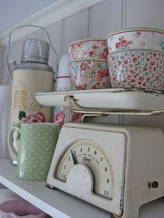 Maybe decoupage cool paper or glue fabric to dishes to match kitchen colors  . . . .