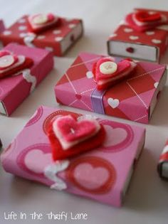 matchbox valentines filled with chocolates, stickers, tattoos, heart shaped erasers, etc...