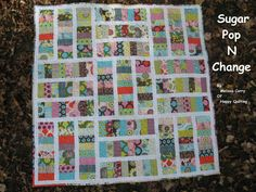 Sugar Pop N Change Quilt-by Melissa Corry-You'll need: 1 Sugar Pop Jelly Roll 1 Sugar Pop Charm Pack 1 Yard of Bella Solids White 1 1/4 Yard of Coordinating Print for Pieced Backing...Separate your jelly roll into two piles.  One pile with 22 strips and one pile with 18 prints. Try to evenly distribute the colors and prints..Sugar Pop N Change Quilt measuring 53″ x 53″.