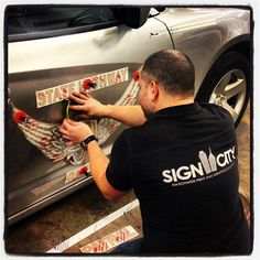 Ohio State Highway Patrol - Omar putting the Decal Package on the New Fleet of Vehicles. Sign City Columbus