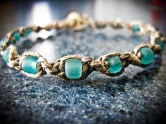 Hey, I found this really awesome Etsy listing at http://www.etsy.com/listing/83363768/natural-blue-glass-hemp-bracelet