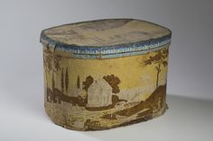 "ERIE CANAL SERIES. A HATBOX WITH LANDSCAPE. Height 12 inches, length 18 inches. Literature: Lilian Baker Carlisle, ""Hat Boxes and Bandboxes at Shelburne Museum, p.134 Est. $400-$800"