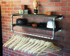 Darling Industrial clothing rack with two 6 inch bars split to either side for a total of 12 inches Pot Hanger, Hanger Rack, Boutique Interior, Adhesive Wall Hooks, Pipe Furniture, Furniture Cleaning, Furniture Stores, Clothing Storage, Clothing Racks