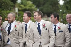 Groomsmen in tan and navy suits